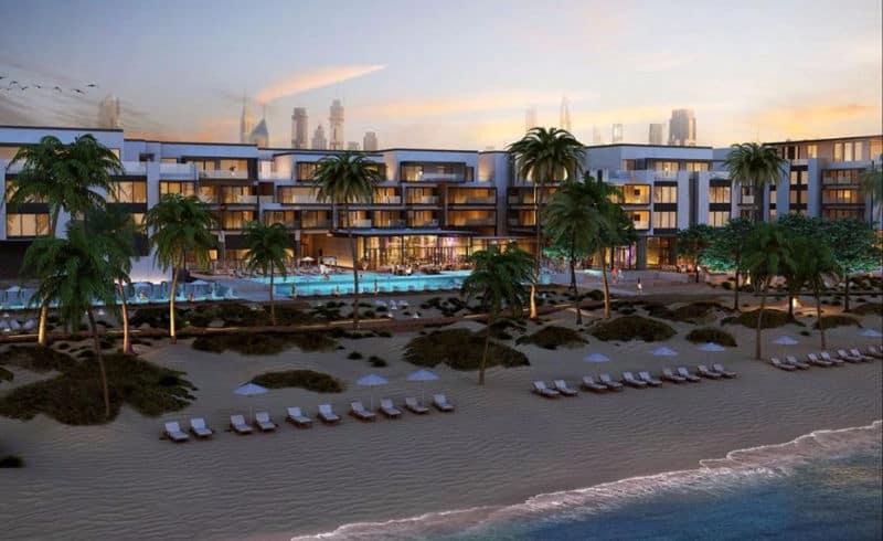 Nikki Beach s centrem Dubaje decentně v pozadí